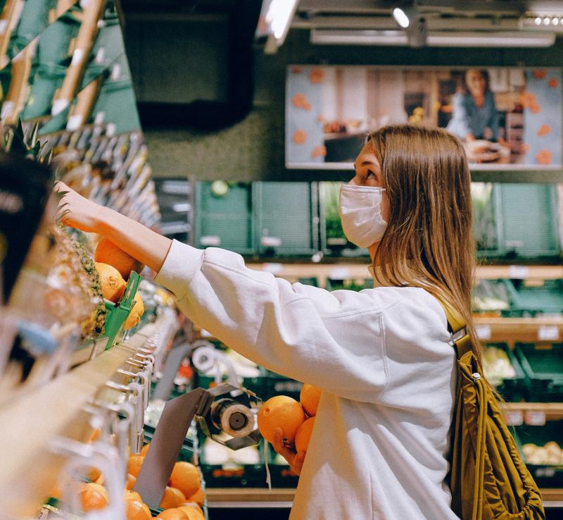 teen girl grocery shopping during the COVID-19 pandemic wearing a mask